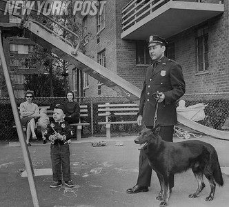 New York Police officer and Police Dog visit children at a local park. 1962