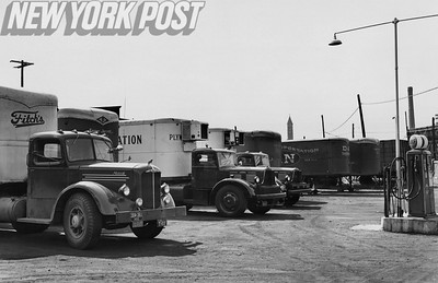 Trucks park at Gulf station, stopped by strikers at Holland tunnel. 1946
