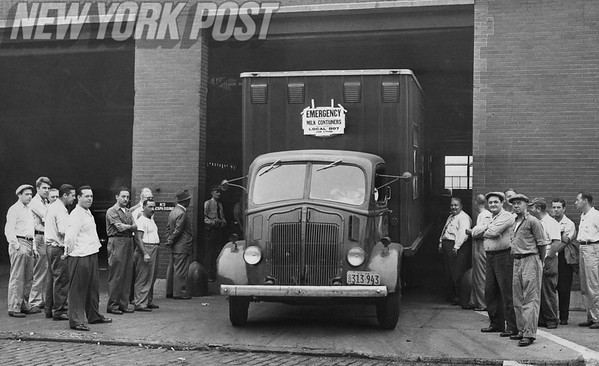 Emergency milk containers leave Brooklyn plant with striking teamsters looking on. 1948