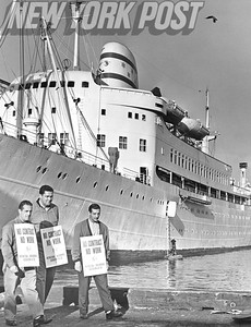 Three longshoremen picket in front of the SS Israel. 1962