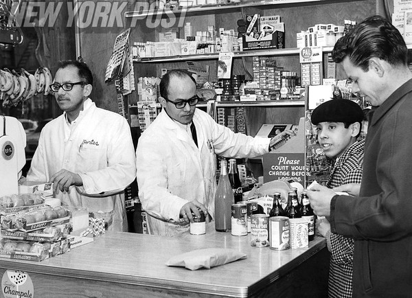 New York residents purchase goods at Cortes, a local grocery store.