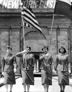 U.S Army Women's Corp carries flags in front of Fort Jay. 1957