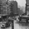Historical street scene of Sixth Avenue after the demolition of the elevated railway. 1941
