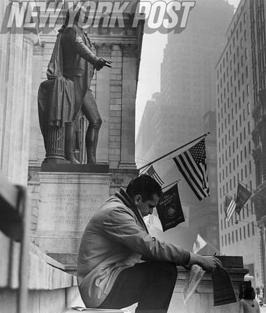 Man rests on the steps of Federal Hall National Memorial. 1964