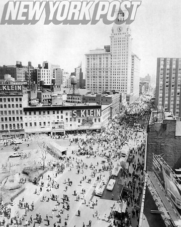 Barney Stein takes a photo of New York City residents crowding 14th Street. 1970