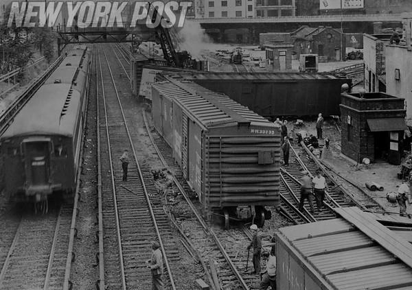 Train derails and blocks three tracks into Grand Central Station. 1962