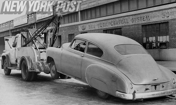 Tow Truck hooks onto a 1950's Model Chevrolet. 1961