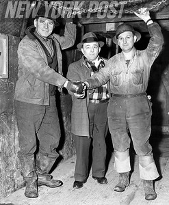 Tunnel workers celebrate going back to work in Battery Tunnel. 1948