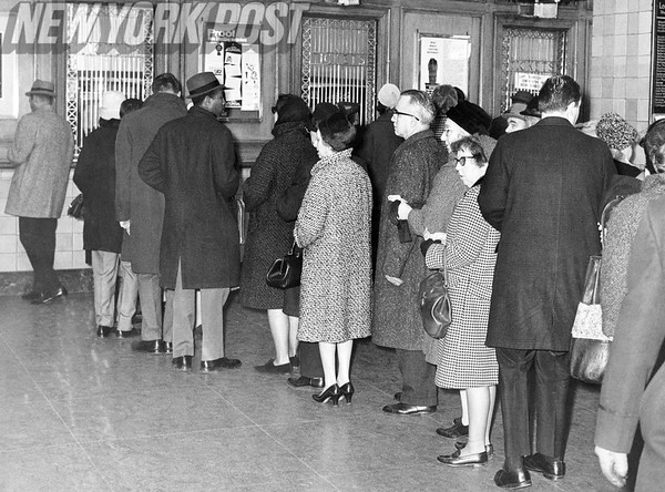 New York City Transit Strikes cause patrons to line up to pay the fare. 1957
