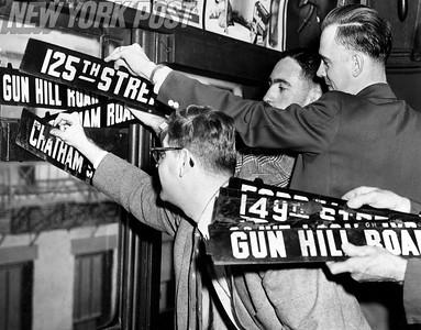 Passengers grab souvenirs of the last  3rd Ave El train. 1955