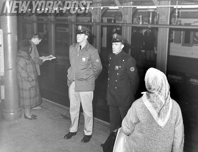 NYC Police monitor the subway platform in Grand Central Station.1965