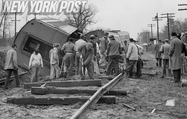 Workers clean up the wreckage of Long Island Railroad coaches. 1963