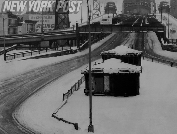 The Queensboro Bridge is empty at 4 p.m. due to weather conditions.