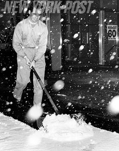Thomas McKeown tries to keep his sidewalk clear of ice and snow. 1961