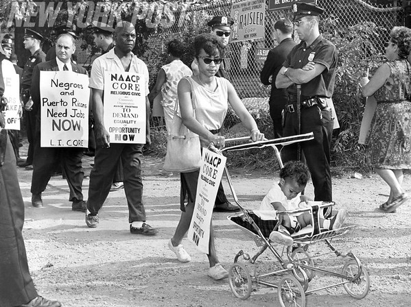Citizens form picket line at Rochdale Village for increased employment of minorities. 1963