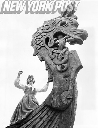 Bettyann Brock waves from the dragon's head of a 69 foot Viking ship that arrived on the SS Oslofjord. 1958