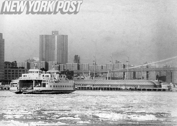 East River piers are endangered by the oil slick caused by the wreck of the Empress Bay. 1977