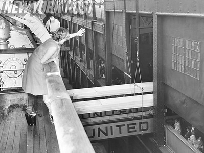"Arrival of the ship, ""America"", into New york City. Carol Finn waves hello to the crowd waiting to see their loved ones that just arrived. 1961"