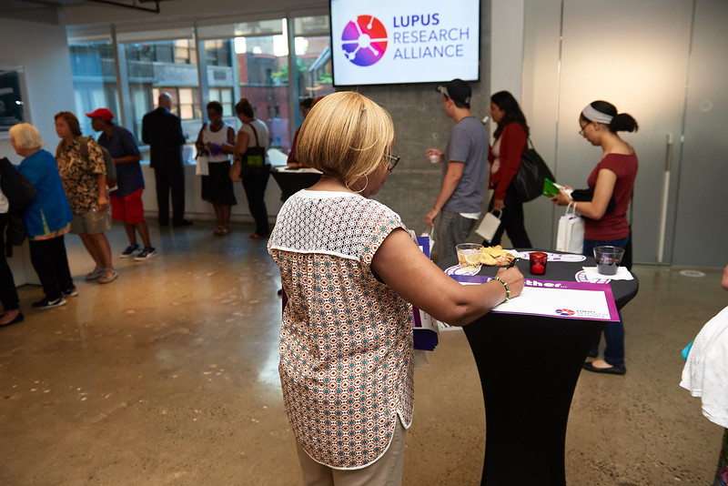 A reception and info panel about lupus at I Heart Media