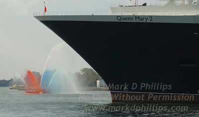 QM2 with Fireboat