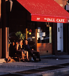 A couple sits outside the Fall Cafe with their dog on Smith Street in Carroll Gardens, Brooklyn.