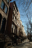 Brownstones line Clinton Street as far as the eye can see in Cobble Hill Brooklyn