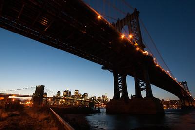 The Manhattan Bridge frames Manhattan and the Brooklyn Bridge at sunset 2/29/08 from the new Brooklyn Bridge Park in the decade of no skyscraper in Lower Manhattan