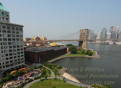 The Sweeney Building, Brooklyn Bridge Park, Brooklyn Bridge, Tobacco Warehouse, Fulton-Ferry State Park, East River, and lower Manhattan all come together in DUMBO from the walkway on the Manhattan Bridge.