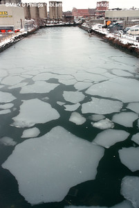 Ice floats in the Fourth Street Basin of the Gowanus Canal during a harsh January freeze in 2000. The current cost of the overall EPA Superfund cleanup plan is estimated to be over $1.5 billion, and the entire project won't be completed until mid-2023. The Gowanus Canal is located in one of the densest population centers in America.