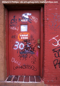 Graffitti covered doorway near Gowanus Canal in Brooklyn, NY, in 1996. Graffiti was found nearly everywhere in the canal's vicinity.