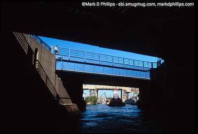 A Barge approaches the Hamilton Avenue bridge on the Gowanus Canal with the Ninth Street subway station behind in 1991. One of five bridges over the waterway, the 1.7 mile long canal is currently in an EPA Superfund cleanup plan that is estimated to be over $1.5 billion, and the entire project won't be completed until mid-2023. The Gowanus Canal is located in one of the densest population centers in America.