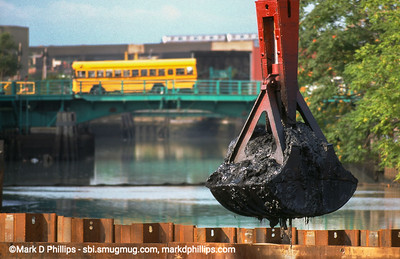 Dredging in the Gowanus Canal in Brooklyn, NY, brought up muck laced with environmental toxins as a school bus crosses the Third Street Bridge during the city-led 1999 cleanup effort that involved repairs to the flushing tunnel and a partial dredging at the head of the waterway. The results were immediate with an increase in fish and wildlife.