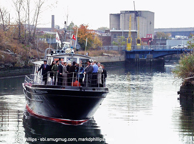 The Brooklyn Center for the Urban Environment offers first boat cruise on the Gowanus Canal in June 1997 with executive director John Muir. They found dissolved oxygen at just 2.8 ppm (need 5ppm for fish life) and light can penetrate only 2 feet (need 6 for plant life). On board the tour was Buddy Scotto, NY Assemblywomen Joan Millman, and US Congresswoman Nydia Valesquez.