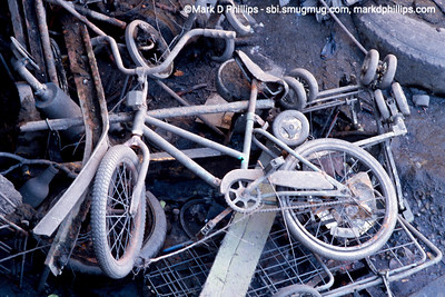 Junk including bicycle revealed at low tide in the Gowanus Canal in 1998 beneath the Carroll Street bridge. A city-led 1999 cleanup effort involved repairs to the flushing tunnel and a partial dredging at the head of the waterway. The results were immediate with an increase in fish and wildlife.