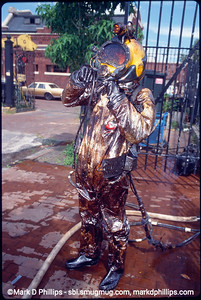 Diver is covered in oil and muck after leaving the water of  the Gowanus Canal during the city-led 1999 cleanup effort that involved repairs to the flushing tunnel and a partial dredging at the head of the waterway. The results were immediate with an increase in fish and wildlife. The divers had challenging conditions, coming out covered in oil and tar and working conditions with no visibility underwater.