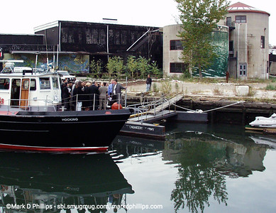 The Brooklyn Center for the Urban Environment offers first boat cruise on the Gowanus Canal in 1997 with executive director John Muir. They found dissolved oxygen at just 2.8 ppm (need 5ppm for fish life) and light can penetrate only 2 feet (need 6 for plant life). On board a tour in 2000 was Buddy Scotto, NY Assemblywomen Joan Millman, and US Congresswoman Nydia Valesquez as they dock at David Lefkowitz's property beside the Carroll Street Bridge.