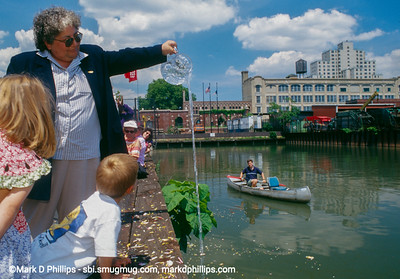 Earth Day on the Gowanus Canal in Brooklyn, NY, in 1999. Jeanne from the Gowanus Canal Community Development Corporation and Owen Foote in the canoe lead a community day at Brooklyn's Superfund waterway.