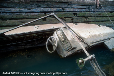 A sunken boat in the Gowanus Canal is corroded white as it sits by the bulkhead in the Fourth Street Basin where Whole Foods now resides. Sunken boats were a common site in the waterway. The 1.7 mile long canal is currently in an EPA Superfund cleanup plan that is estimated to be over $1.5 billion, and the entire project won't be completed until mid-2023. The Gowanus Canal is located in one of the densest population centers in America.