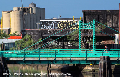 Carroll Street Bridge over the Gowanus Canal in Brooklyn, NY with graffitti in 2000. One of five bridges over the waterway, the 1.7 mile long canal is currently in an EPA Superfund cleanup plan that is estimated to be over $1.5 billion, and the entire project won't be completed until mid-2023. The Gowanus Canal is located in one of the densest population centers in America.