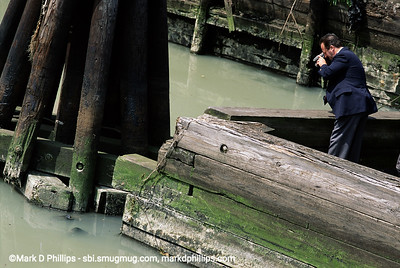 An NYPD Detective photographs a dead body floating in the Gowanus Canal in Brooklyn, NY at the Carroll Street Bridge. The Gowanus has a long history as a place the mob used to get rid of problems. The current cost of the overall EPA Superfund cleanup plan is estimated to be over $1.5 billion, and the entire project won't be completed until mid-2023. The Gowanus Canal is located in one of the densest population centers in America