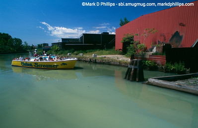 Chelsea Screamer boat tour on the Gowanus Canal in 1998 with the water a distinct pea colored soup. The large red metal warehouse was beside the Carroll Street Bridge, as far as the boat could go up the canal.