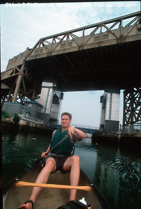 Owen Foote canoes in the Gowanus Canal under the Smith-Ninth Street Subway station in 1999. The current cost of the overall EPA Superfund cleanup plan is estimated to be over $1.5 billion, and the entire project won't be completed until mid-2023. The Gowanus Canal is located in one of the densest population centers in America.