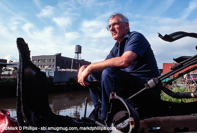 Dan of Two Dans on the banks of the Gowanus Canal in Brooklyn, NY, just north of the Carroll Street Bridge. The Auto Salvage company was one of the few businesses still operating along the canal in 1996.