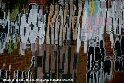 """Since 2016, the patch of graffiti on a warehouse by the Carroll Street Bridge on the bank of the Gowanus Canal was a beautiful artwork on the waterway. But just like the Canal itself, it became a victim of gentrification. The former home of Alex Figliolia Water & Sewer, the 65,000-square-foot industrial building disappeared without a trace. On my first visit to the canal since the pandemic struck, I had one of those """"Oh No"""" moments when I drove across the historic Carroll Street Bridge and realized the graffiti covered wall was gone. Not just gone but obliterated like it had never been there."""