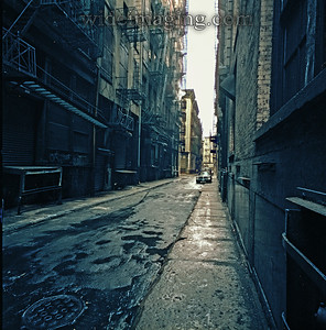 Cortlandt Alley April 1984. This gritty back street, 1 block East of Broadway, runs 4 joggled blocks from Canal Street to Leonard Street. Not far from City Hall this alley still has original solid stone sidewalks and paved over cobblestones.
