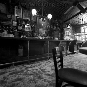 McSorley's, in the East Village (15 E. 7th Street). Established in 1854, is the oldest ale house in New York. A lot of pictures of this great bar are out there but try to find one with no patrons! From July 2000.