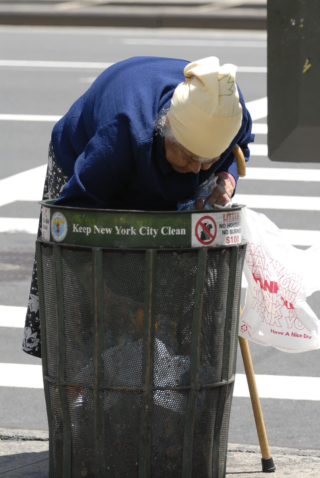 Old Woman in Trash NW Corner 23rd and 8th.
