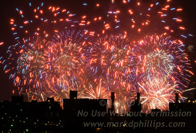 Macy's Fourth of July Fireworks fill the sky with a mosaic of fire above the city from Brooklyn Bridge Park.