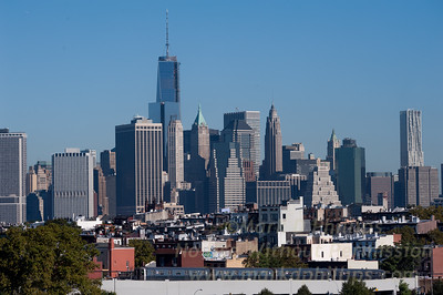 Lower Manhattan and One World Trade Center from the Smith-Ninth Street Subway station looking across Carroll Gardens and the subway in Brooklyn