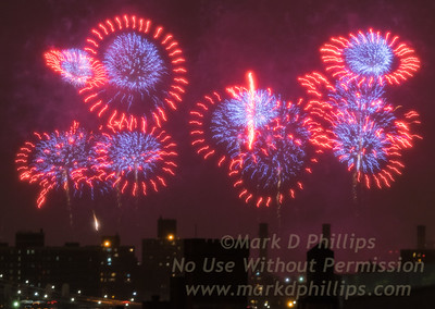 Macy's Fourth of July Fireworks fill the sky  above the city.